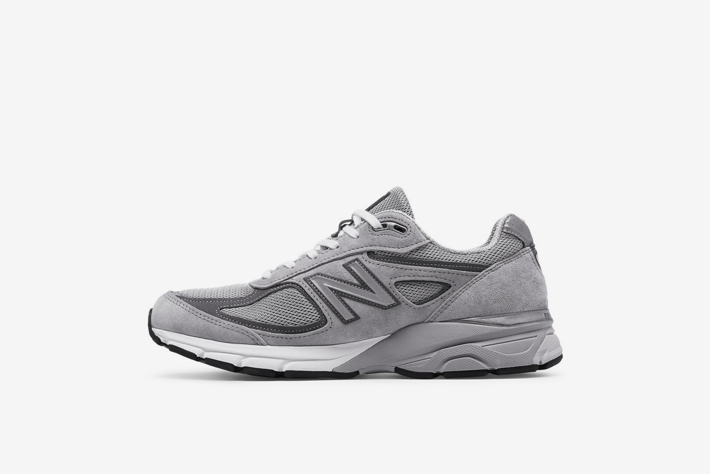 wholesale dealer 86c21 20ea2 The Stüssy x New Balance 990V4 Drops in a Cream Colorway